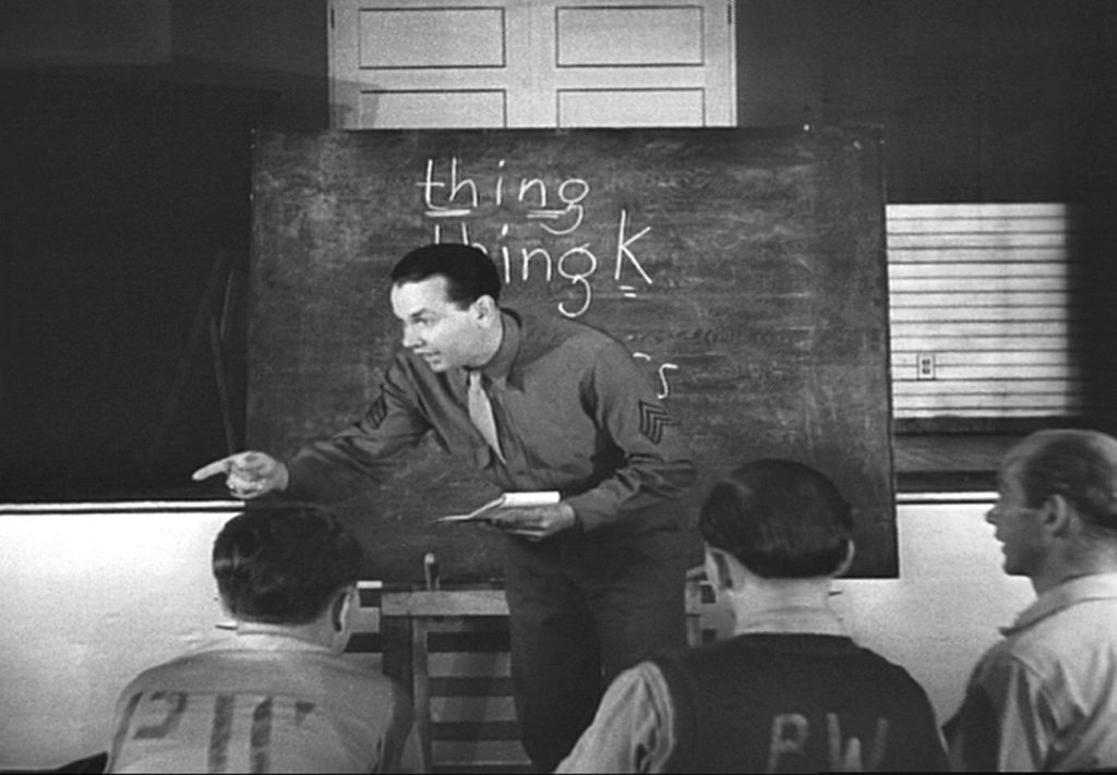 A U.S. Army sergeant teaches English to German POWs at a class at Fort Getty (War Department Video)