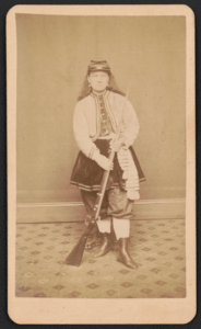 Kady Brownell posing with a rifle, probably in New York City (Library of Congress)