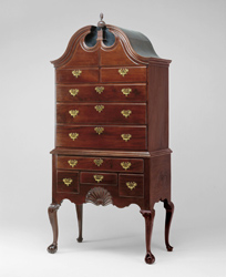 A graceful high chest attributed to John Goddard, 1755/1775. The graceful, curved silhouette of the chest is created by the bonnet-top pediment above and the cabriole legs below (Art Institute of Chicago)