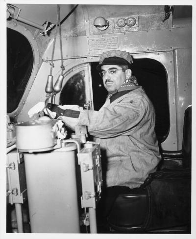Governor John O. Pastore at the throttle for the Merci Train boxcar, February 8, 1949 (Rhode Island State Archives)