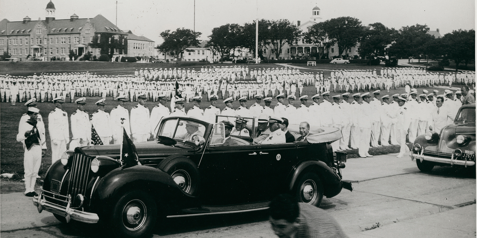 President Roosevelt, in the front passenger seat, reviews cadets on the grounds of the Naval Training Center at Newport (now the grounds of the Naval War College) on August 12, 1940, with Secretary of the Navy Frank Knox , Senator Theodore F. Green and Admiral Edward C. Kalbfus (FDR Library and Naval War College Museum)